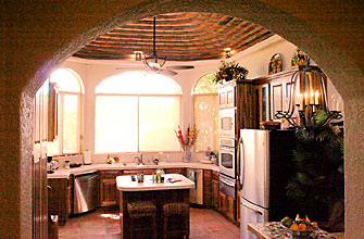 Kitchen through archway at Bahia San Carlos oceanfront house for sale